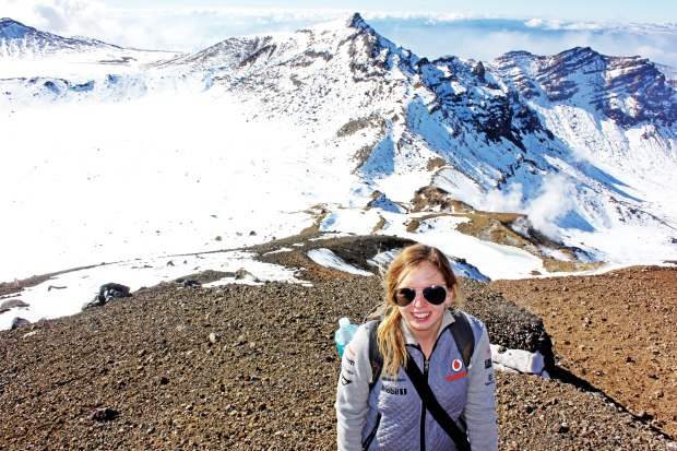 At the top of the red crater - feeling exhausted - snowy Emerald Lakes behind