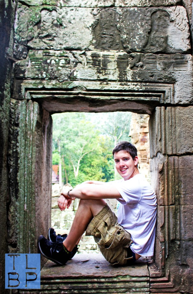 Bayon Temple - Loved using the window to frame this shot of my boyfriend.