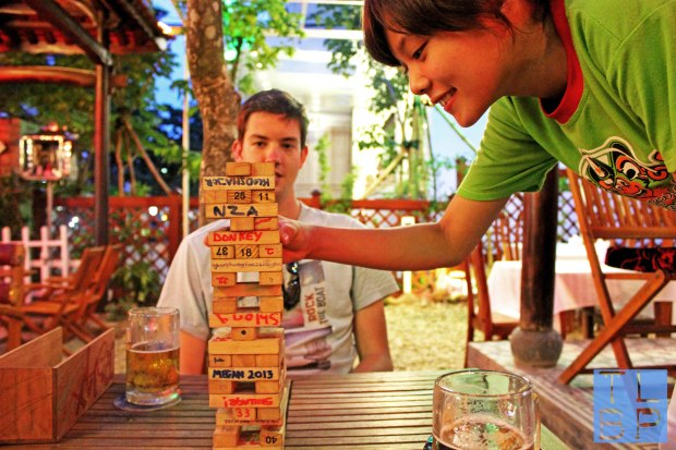 Playing Jenga In A Bar In Hue