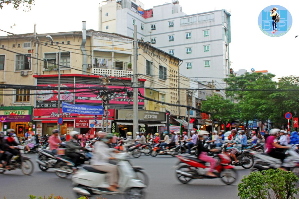 Saigon traffic with Cafe Zoom in the background